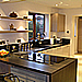 high gloss slab kitchen